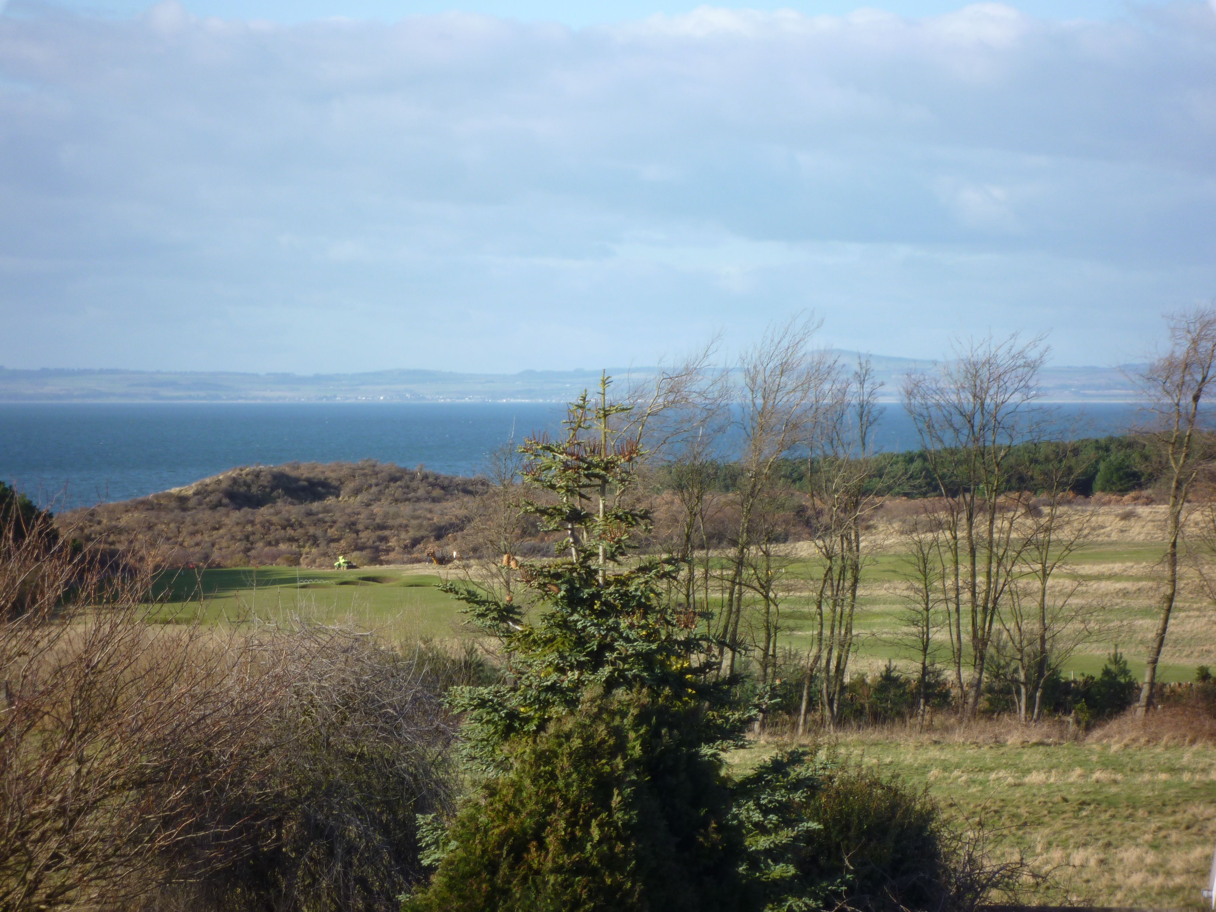 View over golf course and sea.