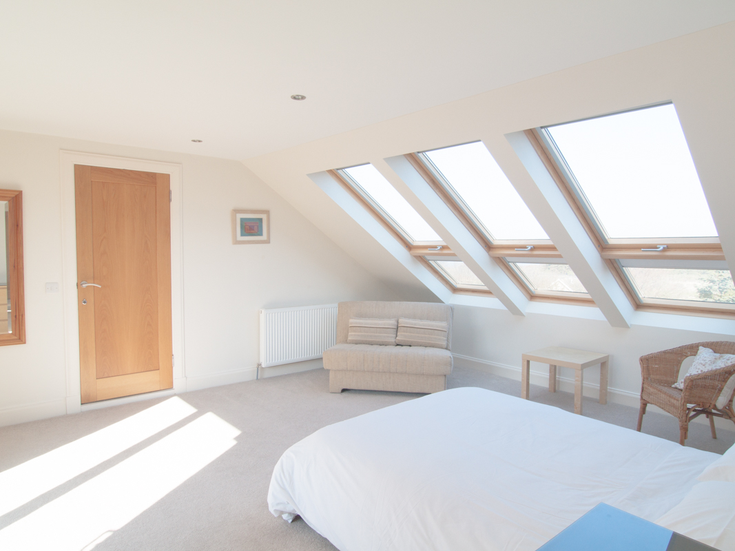 Double bed, sofa bed and six vellum windows overlooking sea